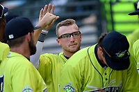 Second baseman Chandler Avant (5) of the Columbia Fireflies is greeted after scoring a run in a game against the Augusta GreenJackets on Friday, May 31, 2019, at Segra Park in Columbia, South Carolina. Augusta won, 8-6. (Tom Priddy/Four Seam Images)