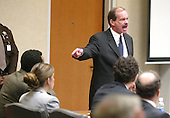 Prince William County (Virginia) Assistant Commonwealth Attorney, James A. Willett, points to John Allen Muhammad as he delivers his closing arguments during the penalty phase of the trial of convicted sniper John Allen Muhammad courtroom 10 at the Virginia Beach Circuit Court in Virginia Beach, Virginia on November 20, 2003.<br /> Credit: Lawrence Jackson - Pool via CNP