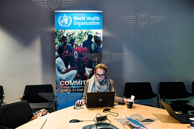 World Health Organization (WHO) staff listening in, in an annex room, to the daily, morning Acute Events Management meeting in the SHOC room (Strategic Health Operations Centre), at the World Health Organization (WHO) headquarters. The WHO, monitors global public health events around the clock, and facilitates international collaboration during public health emergencies and daily operations. Current emergency situations, including coronavrius and ebola, were discussed.