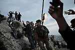 21/03/15 -- Akre, Iraq -- A young man runs towards the top of Akre mountain