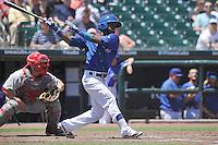 Iowa Cubs Arismendy Alcantara (7) swings during the Pacific Coast League game against the Memphis Redbirds at Principal Park on June 7, 2016 in Des Moines, Iowa.  Iowa won 6-5.  (Dennis Hubbard/Four Seam Images)