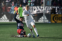 FOXBOROUGH, MA - MARCH 7: Gustavo Bou #7 of New England Revolution slides to tackle Gaston Gimenez #30 of Chicago Fire during a game between Chicago Fire and New England Revolution at Gillette Stadium on March 7, 2020 in Foxborough, Massachusetts.