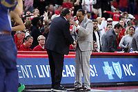 RALEIGH, NC - JANUARY 9: Head coach Kevin Keatts of North Carolina State University shakes hands with Mike Brey of the University of Notre Dame during a game between Notre Dame and NC State at PNC Arena on January 9, 2020 in Raleigh, North Carolina.