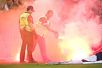 MELBOURNE, AUSTRALIA - OCTOBER 30: Security staff put out the flares during the round 12 A-League match between the Melbourne Victory and Adelaide United at Etihad Stadium on October 30, 2010 in Melbourne, Australia.  (Photo by Sydney Low / Asterisk Images)