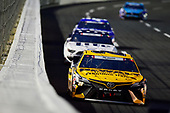 CONCORD, NORTH CAROLINA - MAY 24: Erik Jones, driver of the #20 DEWALT Atomic Thank You Toyota, leads a pack of cars during the NASCAR Cup Series Coca-Cola 600 at Charlotte Motor Speedway on May 24, 2020 in Concord, North Carolina. (Photo by Jared C. Tilton/Getty Images)