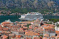 View of cruise ship docked in old town Kotor, a world heritage site, Montenegro
