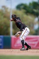 GCL Orioles second baseman Carlos Baez (13) throws to first base during a Gulf Coast League game against the GCL Red Sox on July 29, 2019 at Ed Smith Stadium in Sarasota, Florida.  GCL Red Sox defeated the GCL Pirates 9-1.  (Mike Janes/Four Seam Images)