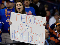 """01 January 2010:  Florida fan holds up a sign says """"Tebow is my homeboy"""" during the game between Florida and Cincinnati during Sugar Bowl at the SuperDome in New Orleans, Louisiana.  Florida defeated Cincinnati, 51-24."""