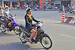 Well Dressed Woman On Scooter