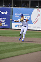Iowa Cubs second baseman Ian Happ (8) throws to first during a game against the Round Rock Express at Principal Park on April 16, 2017 in Des  Moines, Iowa.  The Cubs won 6-3.  (Dennis Hubbard/Four Seam Images)