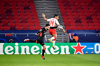 16th February 2021, Puskas Arena, Budapest, Hungary; Champions League football, FC Leipig versus Liverpool FC;   Andy Robertson of Liverpool and Tyler Adams of Leipzig challenge for a high ball