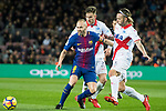 Andres Iniesta Lujan (L) of FC Barcelona battles for the ball with Deportivo Alaves' players during the La Liga 2017-18 match between FC Barcelona and Deportivo Alaves at Camp Nou on 28 January 2018 in Barcelona, Spain. Photo by Vicens Gimenez / Power Sport Images