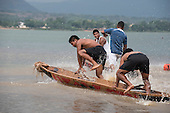 A team jump into their canoe at the beginnning of a heat at the International Indigenous Games, in the city of Palmas, Tocantins State, Brazil. Photo © Sue Cunningham, pictures@scphotographic.com 30th October 2015