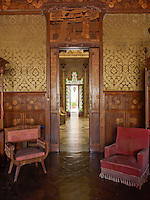 Marquetry panels with flower motifs clad the sitting room walls and a landscape scene decorates the doorway to the Inner Garden