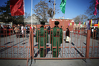 CHINA. Soldiers watching worshippers during Chinese New Year in Baiyun Temple in Beijing.  Chinese New Year, or Spring Festival, is the most important festival and holiday in the Chinese calendar In mainland China, many people use this holiday to visit family and friends and also visit local temples to offer prayers to their ancestors. The roots of Chinese New Year lie in combined influences from Buddhism, Taoism, Confucianism, and folk religions.  2008.