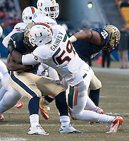 Miami linebacker Jimmy Gaines V (59) makes a tackle.The Miami Hurricanes defeated the Pitt Panthers 41-31 at Heinz Field, Pittsburgh, Pennsylvania on November 29, 2013.