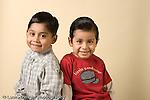closeup portrait of two preschool age boys cousins ages 4 or 5 horizontal