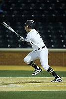 Bobby Seymour (3) of the Wake Forest Demon Deacons follows through on his swing against the Florida State Seminoles at David F. Couch Ballpark on March 9, 2018 in  Winston-Salem, North Carolina.  The Seminoles defeated the Demon Deacons 7-3.  (Brian Westerholt/Four Seam Images)