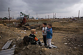 Bibi Heybat, Azerbaijan .December 14, 2006..Just a few meters from the British Petroleum's massive off-shore platform (being built on shore) is one of the poorest districts near Baku. Most of the residents are refugees from Nagorno-Karabakh region settled here during the war.