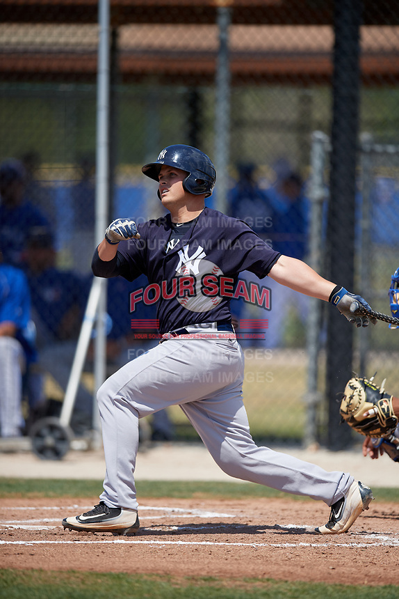 New York Yankees catcher Wes Wilson (69) follows through on a swing during a minor league Spring Training game against the Toronto Blue Jays on March 30, 2017 at the Englebert Complex in Dunedin, Florida.  (Mike Janes/Four Seam Images)