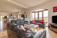 BNPS.co.uk (01202 558833)<br /> Pic: PurpleBricks/BNPS<br /> <br /> Pictured: The living room.<br /> <br /> A luxury ten-bedroom eco-home has gone on sale for offers in excess of £850,000 - the same price as a one-bedroom flat in Chelsea.<br /> <br /> The new owner will buy the chance to become an eco-laird, as the property can be run entirely off-grid and includes four lochs and 38 acres of land which could potentially be re-wilded.<br /> <br /> Leadburn Manor at West Linton is just 12 miles south of Edinburgh in Scotland, but looks out over open countryside.