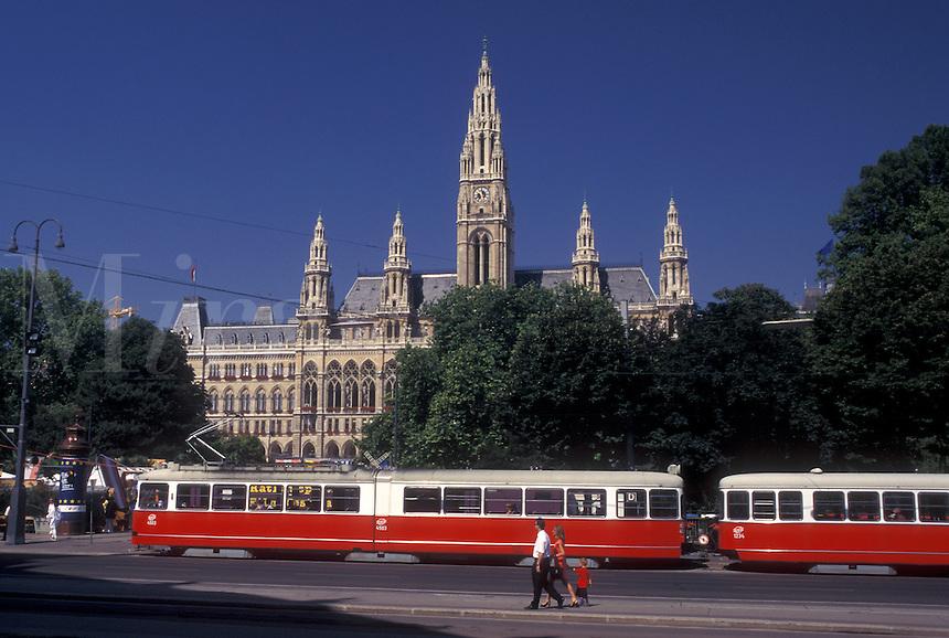 Vienna, Austria, Wien, Red tram passes in front of City Hall in downtown Vienna.