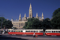 Vienna, Austria, Wien, Red tram passes in front of City Hall in downtown Vienna.