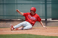 Philadelphia Phillies Danny Zardon (23) slides home during a minor league Spring Training game against the Pittsburgh Pirates on March 24, 2017 at Carpenter Complex in Clearwater, Florida.  (Mike Janes/Four Seam Images)