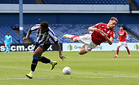 Nottingham Forest's Matty Cash goes down under the challenge from Sheffield Wednesday's Kadeem Harris <br /> <br /> Photographer Rich Linley/CameraSport<br /> <br /> The EFL Sky Bet Championship - Sheffield Wednesday v Nottingham Forest - Saturday 20th June 2020 - Hillsborough - Sheffield <br /> <br /> World Copyright © 2020 CameraSport. All rights reserved. 43 Linden Ave. Countesthorpe. Leicester. England. LE8 5PG - Tel: +44 (0) 116 277 4147 - admin@camerasport.com - www.camerasport.com