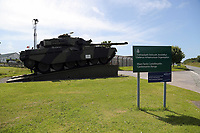 Thursday 15 June 2017<br /> Pictured: A tank by the entrance to Castlemartin range.<br /> Re: A soldier has been killed and three others injured after an incident involving a tank at a Ministry of Defence base in Pembrokeshire.<br /> The soldier, from the Royal Tank Regiment, died in the incident at Castlemartin Range.<br /> Two people were taken to Morriston Hospital in Swansea, while another casualty remains in Cardiff's University Hospital of Wales.<br /> An investigation is under way.<br /> Live firing was scheduled to take place at the range between Monday and Friday.<br /> In May 2012, Ranger Michael Maguire died during a live firing exercise at the training base. An inquest later found he was unlawfully killed.