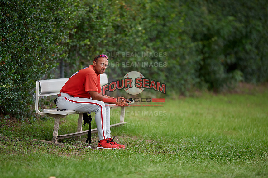 GCL Phillies West manager Nelson Prada (57) sits on a bench away from the field after being ejected from a game against the GCL Blue Jays on August 7, 2018 at Bobby Mattick Complex in Dunedin, Florida.  GCL Blue Jays defeated GCL Phillies West 11-5.  (Mike Janes/Four Seam Images)