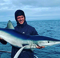 BNPS.co.uk (01202) 558833. <br /> Pic: AnglingAndAnxiety/BNPS<br /> <br /> With Video - Download: https://we.tl/t-WGwExzoqIw<br /> <br /> Pictured: Kevin caught this blue shark in October 2020. <br /> <br /> An angler who only took up the sport a year ago has caught the 'big four' of native sea fish by landing a deadly 256lb thresher shark.<br /> <br /> Kevin Finch is one of just a handful of fisherman to have claimed all four big game species.<br /> <br /> Video footage shows the dramatic moment Kevin pulled in the 6ft long shark, with a tail as long as it's body, alongside his boat off the coast of Bournemouth, Dorset.
