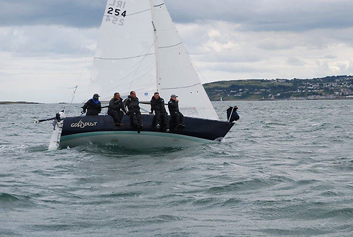 Scorie Walls and team on Goldust placed first overall in the Puppeteer 22 class in this year's Lambay Race