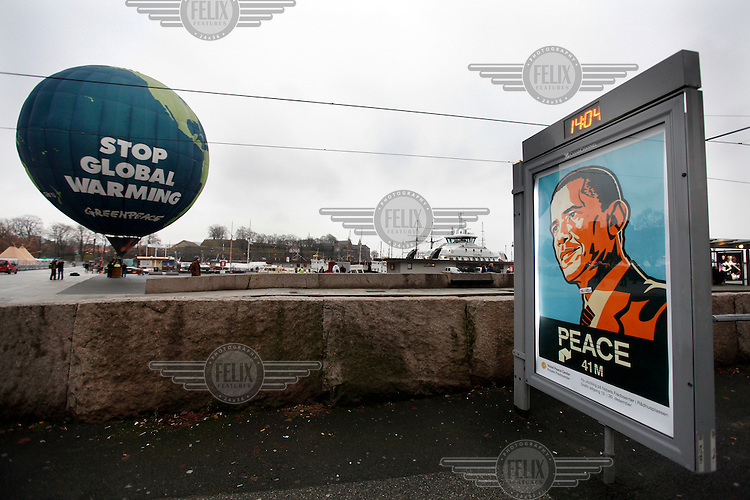 (Oslo, Norway. Dec 8, 2009) Greenpeace hot air balloon outside Oslo Town Hall, where US president Barack Obama will receive Nobel Peace Prize on Dec 10 2009. Balloon reads Stop Global Warming.