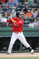 First baseman Sam Travis (28) of the Greenville Drive bats in a game against the Savannah Sand Gnats on Friday, August 22, 2014, at Fluor Field at the West End in Greenville, South Carolina. Travis is a second-round pick of the Boston Red Sox in the 2014 First-Year Player Draft out of Indiana University. Greenville won, 6-5. (Tom Priddy/Four Seam Images)