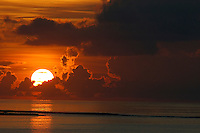 Sunrise rising up over clouds and sea, Maldives.