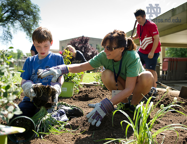 Jul. 30, 2013; Theresa McKenna '89, of Houston, TX and her son Carter plant flowers at Healthwin Hospital in South Bend as part of the Alumni Association Family Volunteer Camp.<br /> <br /> Photo by Matt Cashore/University of Notre Dame