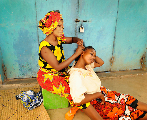 A beautician at her street front  shop in Likoni, Kenya.