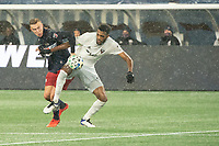 FOXBOROUGH, MA - NOVEMBER 1: Adam Buksa #9 of New England Revolution and Donovan Pines #23 of DC United battle for the ball during a game between D.C. United and New England Revolution at Gillette Stadium on November 1, 2020 in Foxborough, Massachusetts.