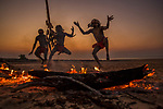 Aboriginal men perform an ancient dance near the coast of Arnhem Land on Australia's northern border. A permit is required to travel in this region of Arnhem Land, an Aboriginal center. The quality of ancient art on rock walls, as well as the modern Aboriginal art and customs, continually amazed me during my visit.