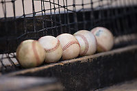 A row of baseballs sit on the top step in the Kannapolis Intimidators dugout during the game against the Hagerstown Suns at Kannapolis Intimidators Stadium on May 6, 2016 in Kannapolis, North Carolina.  The Intimidators defeated the Suns 5-3.  (Brian Westerholt/Four Seam Images)