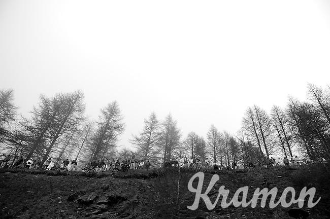 2013 Giro d'Italia.stage 14: Cervere - Bardonecchia.168km..fans await the riders in the rain and mist