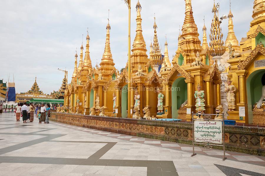 Myanmar, Burma.  Shwedagon Pagoda, Yangon, Rangoon.  Shrines to Nats, Buddhist spirits worshipped in Myanmar, line the Walkway around the Stupa.