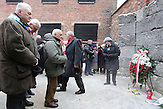 Former prisoners , together with the management of Auschwitz laid flowers and lit candles at the Death Wall of Auschwitz paying tribute to the victims of the Nazis.