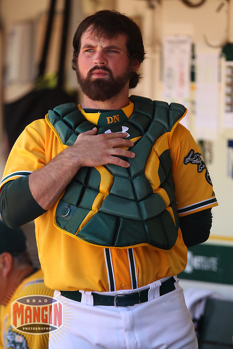 OAKLAND, CA - JULY 4:  Derek Norris #36 of the Oakland Athletics puts on his catcher's gear in the dugout during the game against the Boston Red Sox at O.co Coliseum on Saturday, July 4, 2012 in Oakland, California. Photo by Brad Mangin