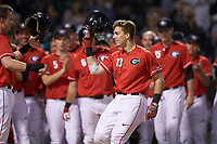 Michael Curry (13) of the Georgia Bulldogs is greeted by teammates at home plate after hitting a pinch-hit three run home run against the Charlotte 49ers at BB&T Ballpark on March 8, 2016 in Charlotte, North Carolina. The 49ers defeated the Bulldogs 15-4. (Brian Westerholt/Four Seam Images)