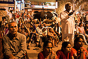 Some take photos using mobile phones while other pilgrims look on while they attend the evening prayers at the at the Dashashwamedh Ghat in the ancient city of Varanasi in Uttar Pradesh, India. Photograph: Sanjit Das/Panos