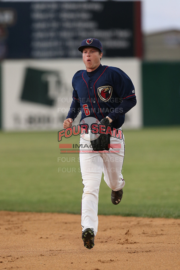 Brett Phillips (6) of the Lancaster JetHawks returns to the dugout during a game against the Modesto Nuts at The Hanger on April 25, 2015 in Lancaster, California. Lancaster defeated Modesto, 5-4. (Larry Goren/Four Seam Images)