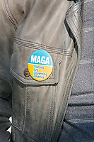 """A crowd gathers in Boston Common for the 2020 Women's March protest in opposition to the re-election of US president Donald Trump in Boston, Massachusetts, on Sat., Oct. 17, 2020.<br /> The button here reads """"MAGA: Morons are governing America."""""""