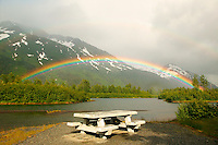 Rainbow over small lake and picnic area Portage Valley, Alaska